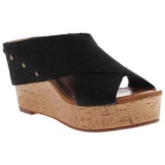 The Adonis will make you feel like a Greek goddess as you saunter down the boardwalk. Its modest cork wedge gives it a summery flair while the natural fabric criss cross creates a comfortable, casual feel. Choose beige for a stroll along the tides-swept coast; select black for a more classic look.