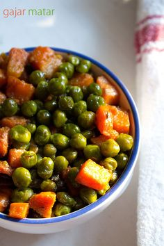 Carrot and Peas with Cumin, Green Chilis, and Ginger *** increased Garam Masala to 1 tsp, and added 2 tsp Coriander Powder in place of the Cilantro