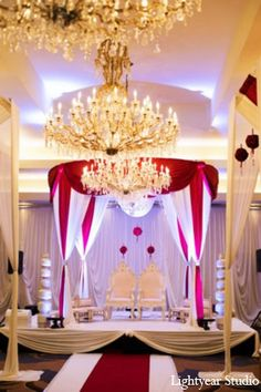 The bride and groom take part in Hindu wedding rituals and customs, under a romantic mandap.