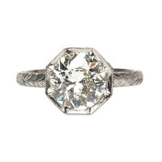 not really a bezel, but I LOVE all things octagon and love the profile of this one.    Trumpet & Horn Edwardian Inspired Diamond Engagement Ring | From a unique collection of vintage engagement rings at http://www.1stdibs.com/jewelry/rings/engagement-rings/
