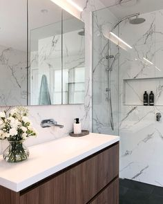 @aliciajeffries_design from @mint_kitchen_group designed this stunning bathroom in marble, timber and chrome is everything we dream of. Featured here is our #garethashton products in chrome. Visit an Abey Selection Gallery near you to see more on our collections