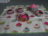 Crochet tea set with cakes, biscuits and fruit