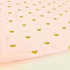 This gold heart print on pink fabric is perfect for baby quilts, gowns, aprons, wedding table runners and place mats, pillows and home decor. Available by the square, fat quarter, half yard or yard. This fabric is 100% cotton. Please select your size preference from the drop-down menu. You may purchase more than one yard by adjusting the quantity option. Fabric is ready to be shipped in 1-3 business days. Please feel free to send a message with any questions! Thank you