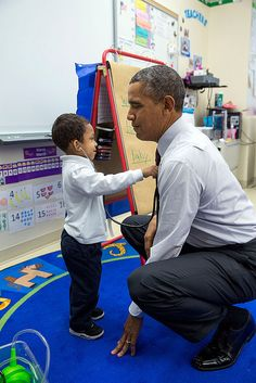 President Barack Obama lets a little boy listen to his heartbeat with a stethoscope during a classroom visit at Powell Elementary School in Washington, D.C., March 4, 2014.