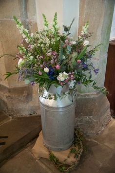 Milk churn arrangement by The Yorkshire Dales Flower Company for Phil and Jane's beautiful wedding. Photo by Kent Photography.