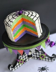 Witch Shoe Cake Recipe: Make this multicolored cake with a spider web finish even more special by building a wooden witch shoe to use as a cake stand.