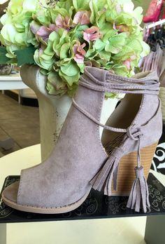 These cute heels are perfect for any season. With tassels and ties at the top, this shoe is made of soft suede leather, and matches with a wide array of clothing!