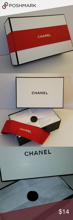 """CHANEL Box w/ Ribbon, Tissue, and Filling CHANEL Box measures approx. 9"""" x 5.5"""" x 3""""  Great for gift giving or decorative storage for your favorite Chanel products!   Includes:  - Red Chanel Gift Ribbon  - Chanel Tissue Paper and Filling CHANEL Other"""