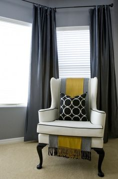 Run a layered scarf down the back of a chair and under the seat cushion.