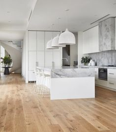 Light and airy white modern kitchen with white oak flooring and spiral staircase. Decor Style Home Decor Style Decor Tips Maintenance Modern Coastal, White Coastal Kitchen, Coastal Style, Timber Flooring, Formal Living Rooms, Modern Kitchen Design, Home Kitchens, Beach Kitchens, New Homes