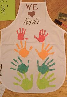 Grandma apron with every grandkids handprints going from youngest to oldest
