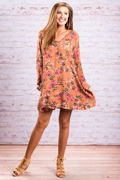 """""""I Just Can't Help Myself Dress, Bronze""""He honestly can't help ourselves! This dress is too amazing not to love! The fit, the print, the colors, everything about this dress is spectacular! #newarrivals #shopthemint"""