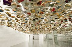 Books suspended above an entrance to the Istanbul modern art museum by Hanif Shoaei