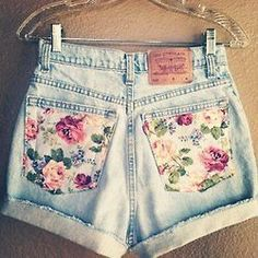 could totally make these- thrift store denim shorts + cute fabric sewn on pockets