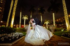 Stealing a Kiss on their Wedding day. #Photo by #DominoArts #Photography (www.dominoarts.com)  #DominoArts #WeddingPhotography #MiamiWedding