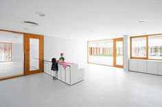 The scale of the child is considered with the custom-designed furniture - with benches that may be knelt on and accessed by the children.