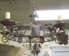 Fabulous antique iron chandelier with crests.