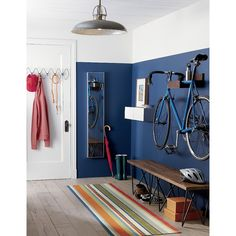 Shop wood bike storage. A space saver for lofts, apartments and studios, clever rack stores your bike off the floor and out of the way. Handcrafted of solid sustainable plantation-grown shesham wood, bicycle rack is notched to hook onto your crossbar.