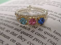 A Grandmothers Ring with the birthstones of all 11 grand kids which include the 8 new grandchildren.