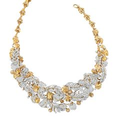 Gold, Platinum and Diamond Bib Necklace, David Webb  18 kt., centering an openwork bib of diamond-set platinum leaves, accented by rope-twist stylized acorns tipped with diamonds and gold leaves, totaling approximately 648 round diamonds approximately 27.00 cts., completed by textured gold stylized branch links, signed Webb, 2 extra links, 8 diamonds missing, approximately 157 dwt. Length 17 inches.