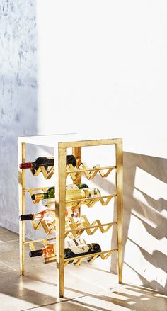 Designed for luxe living, the gold Wine Rack Table will have your party talking.