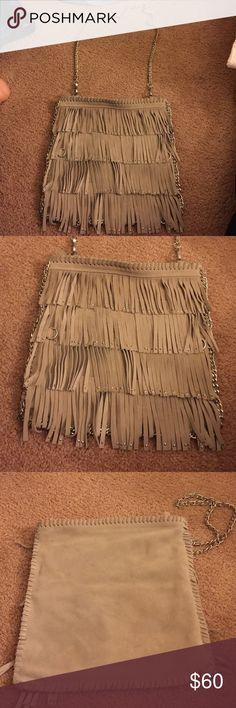 Bebe grey suede fringe messenger bag Bebe grey suede fringe messenger bag. Excellent condition! Inside zipper pocket. 2 built in pockets inside: straps are removable. Great bag! bebe Bags Satchels