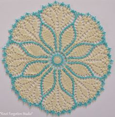 March 2015 CAL. Fern Leaf Doily (aka..Cluster Mania! ) I used Aunt Lydia's size 10 thread in Cream and Artiste thread in Glacier Ice. I used a U.S. size 8 hook.  https://www.pinterest.com/KnotForgottenSt/knot-forgotten-studio/