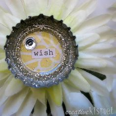 Bottlecap flower brooches - spray paint back of bottle cap, stick circle of pretty paper inside, stick on printed word, surround with circle of glitter, fill with diamond or glass glaze & stick to fake flower & stick brooch pin on back