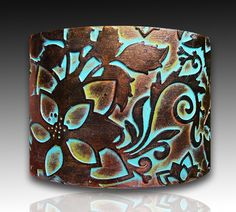 Handmade copper and bronze with patina polymer clay cuff bracelet. $16.00, via Etsy.