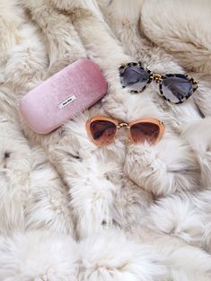 Miu Miu clutch and sunglasses served on a bed of fur....x