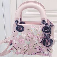 Who would also adore this piece of art? Credit: blackboxconcierge #Diorvalley #LadyDior #Dior #ItBag