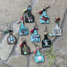 """Livestock Ear Tag Keychain Appx size is 2.188 """" x 3.129 """" They are 1/8 thick. Printed on both sides Key-ring attached with leather strip and accented with a tassel."""
