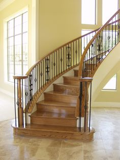 This staircase design was created using Twist series balusters. The long single twist (16.1.21), the single basket double twist (16.1.3), and the twisted heart scroll (16.1.41) pairs seamlessly to create a uniquely designed staircase. These components are available in Satin Black (shown) Silver Vein, Copper Vein, Oil Rubbed Bronze, Oil Rubbed Copper, Antique Nickel. We offer parts, install services, and custom components throughout Texas. Click the image for more information.