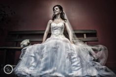 Bride sits on a bench with flowing dress. PaulMichaels Wellington wedding photography http://www.paulmichaels.co.nz/