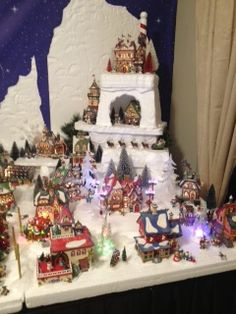 My 2013 village - Department 56 North Pole- 45 houses total.  This section features a cave for the Elf Bunkhouse and Santa's Castle on top.