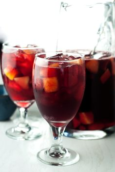 This delicious sangria whips together in just a couple minutes! Why? Because it's the most amazing 3 Ingredient Red Sangria around! Bottoms up!