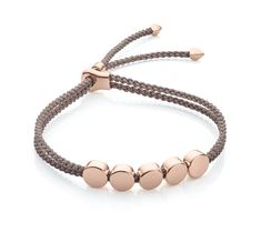 Mink for grace. This sleek friendship bracelet features five flat disks that line up perfectly on a double plaited adjustable cord. Each Linear bead is slidable to create your desired look and can be engraved with numbers, letters or symbols on both sides, introducing a playful new way of making your jewellery unique.