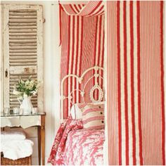 Red and white stripe bedroom decor - vintage iron bed - shutter wall decor - milk glass - cottage
