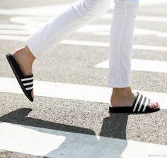 Black and white Adidas slides / Garance Doré