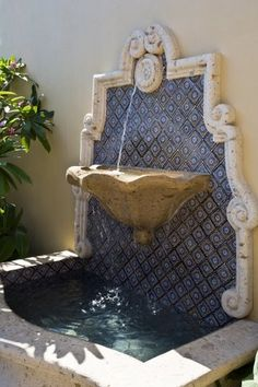 VDM Hacienda - water feature / fountain on the wall with mosaic / tiles as backsplash Handmade tiles can be colour coordinated and customized re. shape, texture, pattern, etc. by ceramic design studios