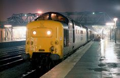 """55010 (D9010) """"THE KING'S OWN SCOTTISH BORDERER"""" waits at Doncaster on the evening of Friday 30th October 1981 with the 1A34 20:19 York - King's Cross service. (Paul Bettany) Electric Locomotive, Diesel Locomotive, Bonde, Night Train, Electric Train, British Rail, Old Trains, Train Engines, Train Tickets"""