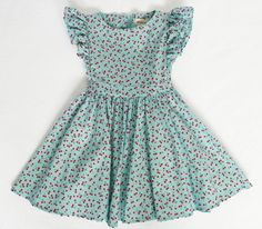 Sleeveless dress with full skirt Waistband ties into a bow at back Hidden zipper in back Approximately knee length cotton **DRESS IS READY TO. Frocks For Girls, Kids Frocks, Kids Outfits Girls, Girl Outfits, Summer Outfits, Little Girl Dresses, Girls Dresses, Little Girl Fashionista, Carnival Dress