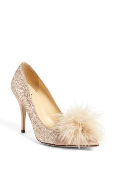 Obsessed with these glitter and feather adorned Kate Spade pumps.