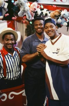 """Alfonso Ribeiro, left, and Will Smith, right, pose with Griffey during filming of the ''Fresh Prince of Bel Air.""""  Junior guest stars in the episode."""
