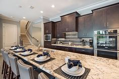 A gourmet kitchen with a gas stove and double ovens… impress the chef in your family!