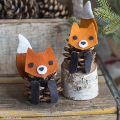 Such cute foxes! Felt Pinecone Fox by lia griffith.