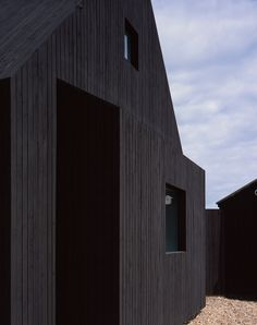 Beach house with dark-stained larch walls in Kent, England