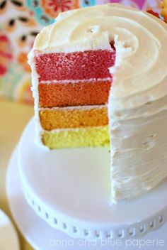 Colorful, layered cake for a Hawaiian-themed party! #cake