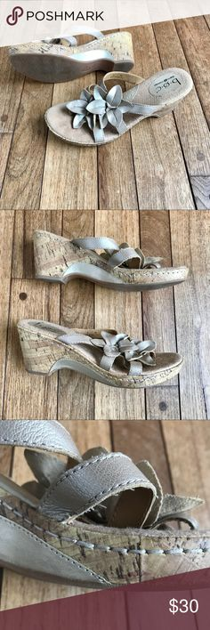 Born Concepts Golden Leather cork wedges w/flowers Very Good Used Condition.  One mark on cork, as shown in photo.  Minor wear on soles.  Some wear on front toe bed, as shown in photos.  B.O.C. Born Concepts cork wedges.  Shimmery light golden leather straps.  Thong style.  Beautiful flowers on top.  Size 8/39. b.o.c. Shoes Wedges