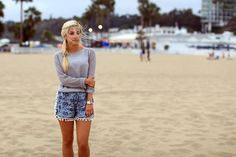 Laid back pom pom shorts and perforated sweater.
